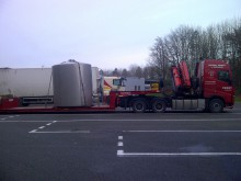 Distillery loaded onto a low loader