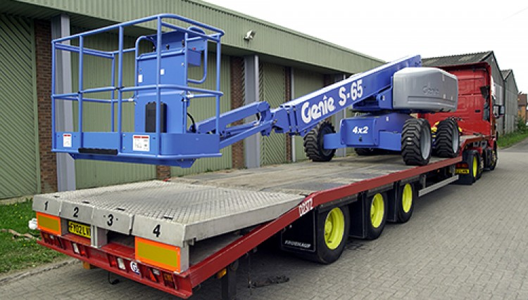 Step frame ramped flatbed trailers