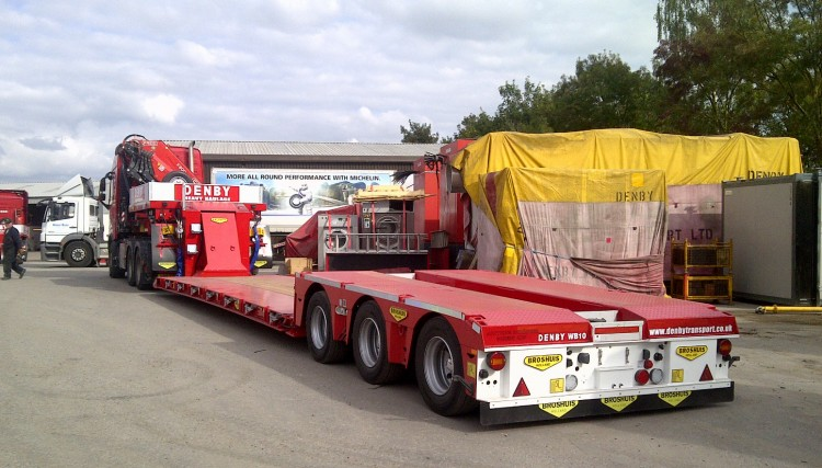 A low loader trailer capable of carrying a heavy load